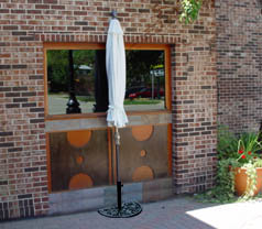 OFF THE WALL BRELLA Is A Half Canopy Champagne Powder Coated Aluminum Patio  Umbrella That Stands, Without Attachment, Flush Against A Wall Or Vertical  ...