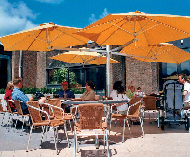 Quad offset umbrella by paraflex pfx quad pole for Outdoor furniture quad cities